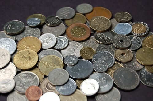 Small pile of US and international coins